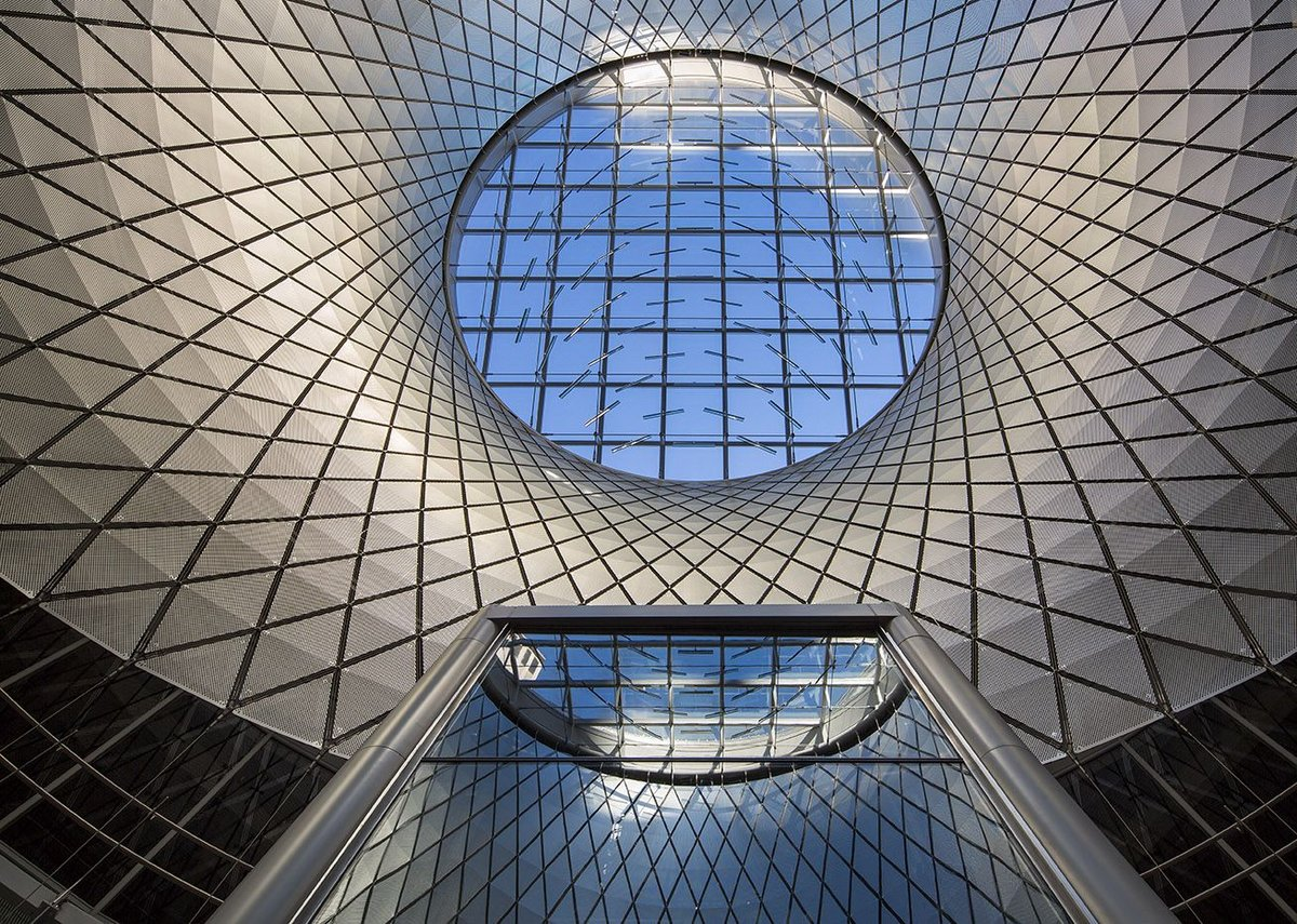 The cable-net structure of the oculus clad in aluminium panels.