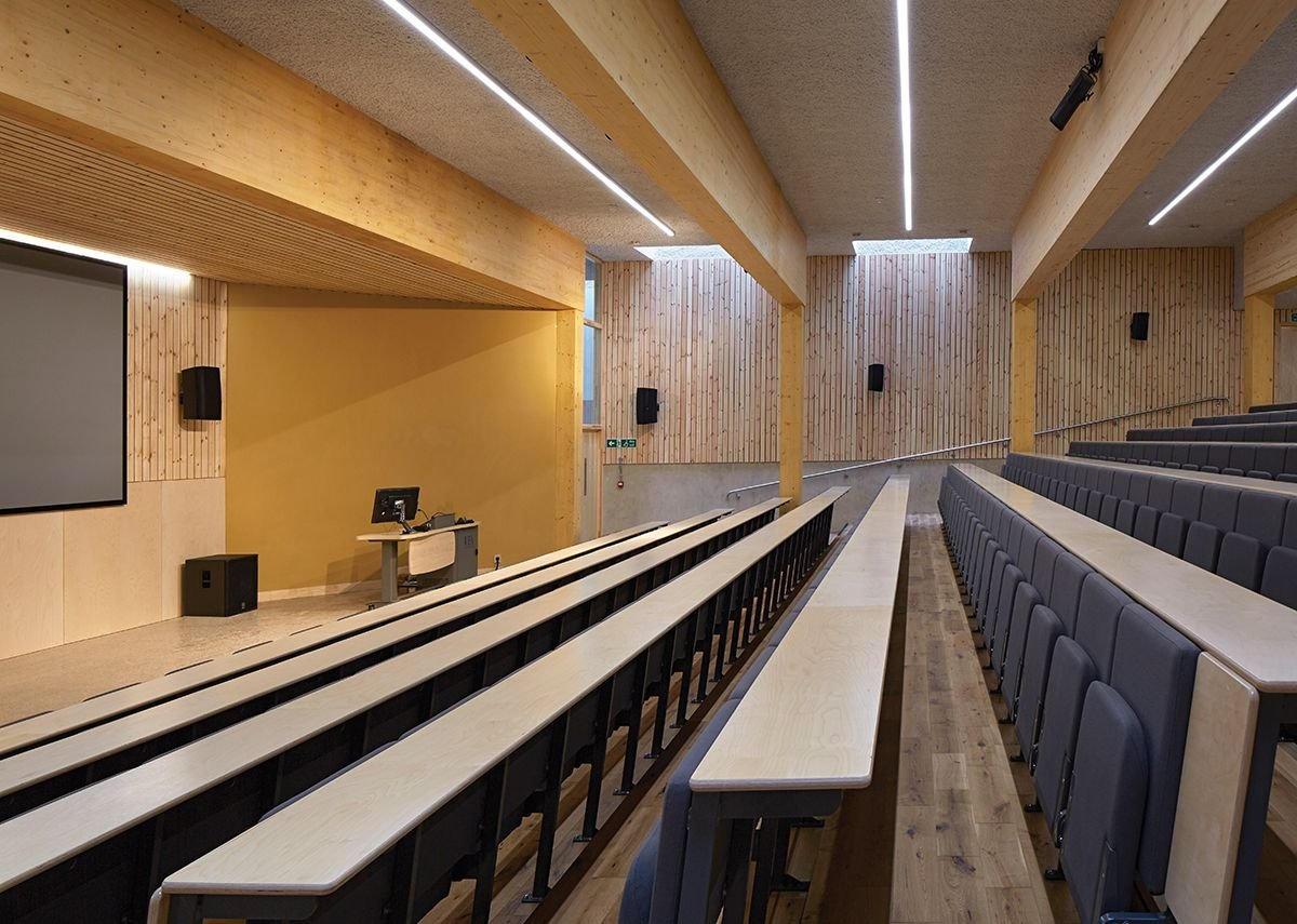 Huge glulams span the wide lecture theatre.