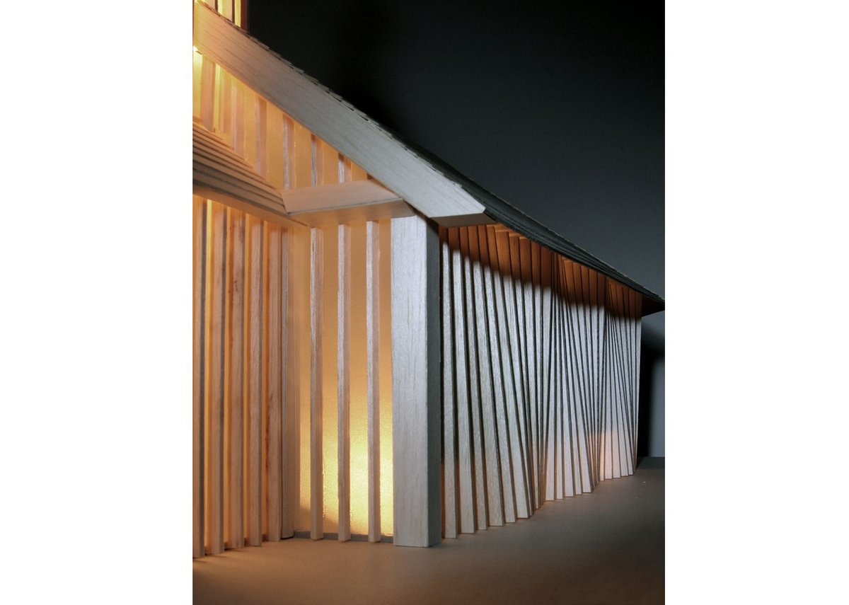 Model detail, showing panels of translucent glass at the south entrance and the undulating ribs of the side elevation.
