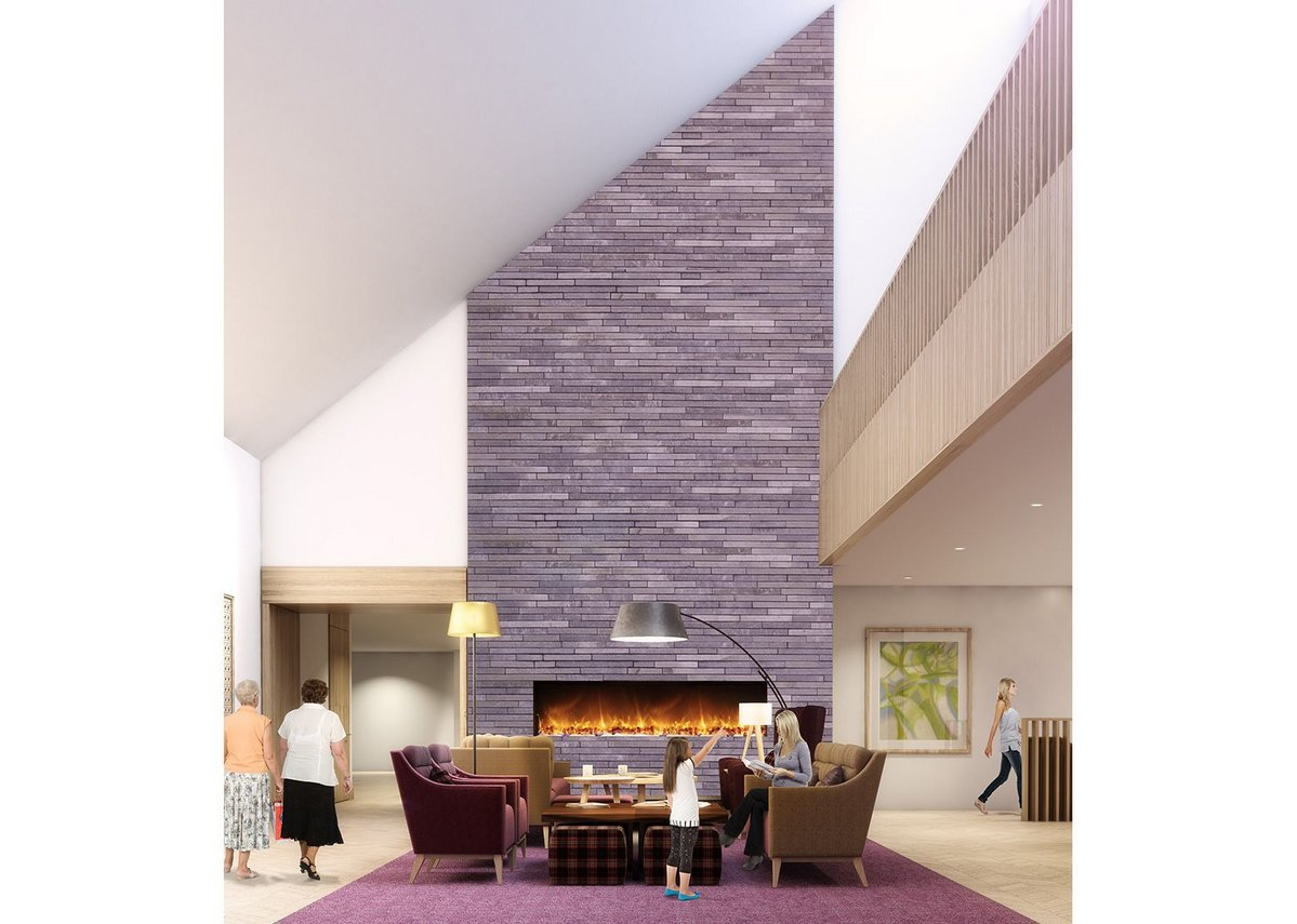 The sitting room and fireplace are the first things one sees on entering the new hospice building.