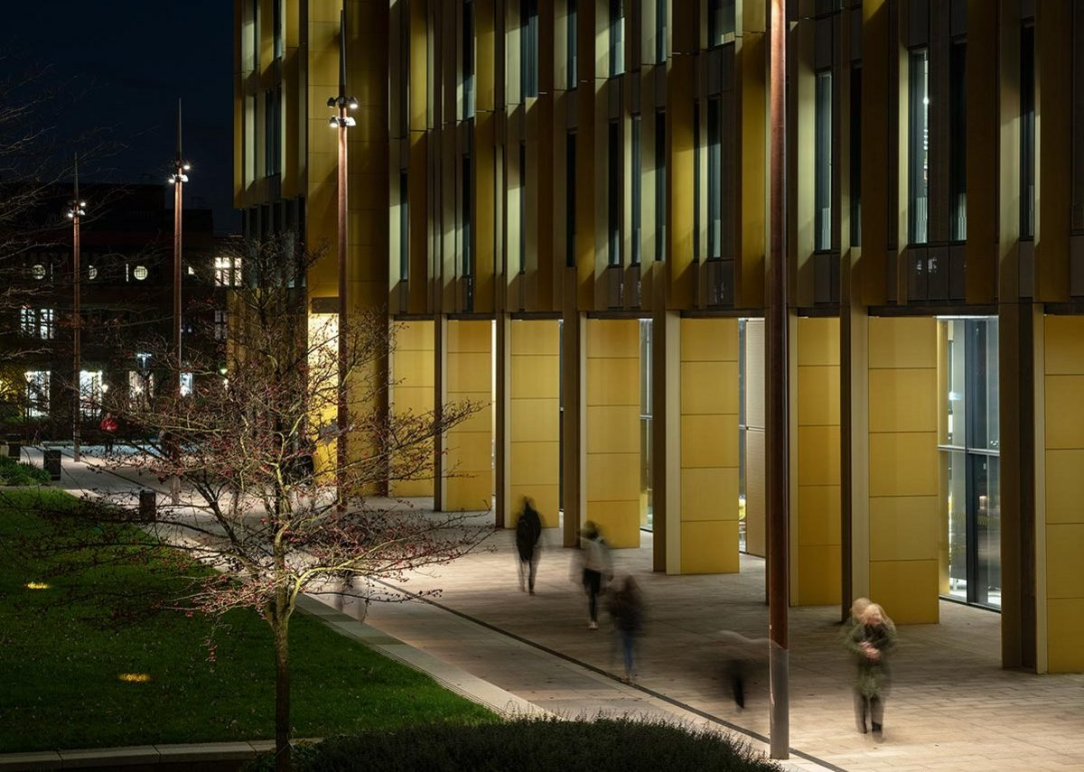 Campus buildings, with their dappled lighting effects, are part of the broader lighting approach.