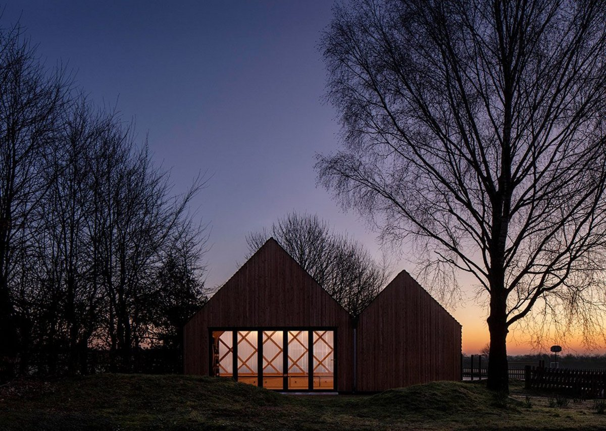 Dusk view of St. John's School Music Pavilion at Lacey Green, Buckinghamshire. Clementine Blakemore initiated the five year project while a student at the Royal College of Art.