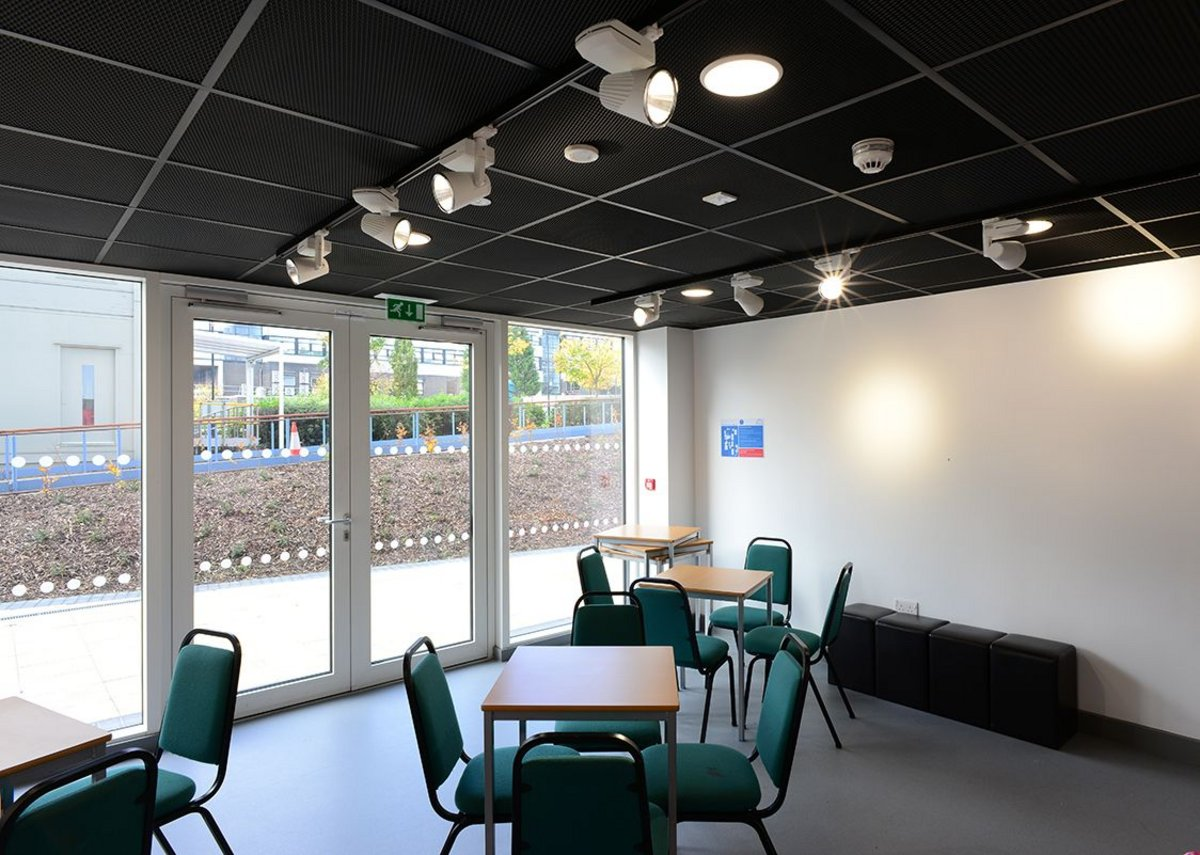 Armstrong  Mesh Metal RB55 in RAL 9005 and Black Plasterboard to Tile Perimeter Trim