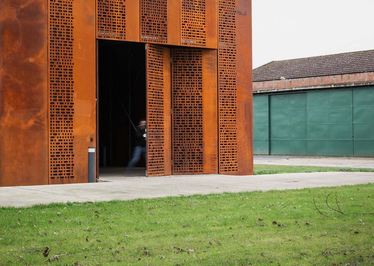 The Corten outer skin also hides the loading bay.