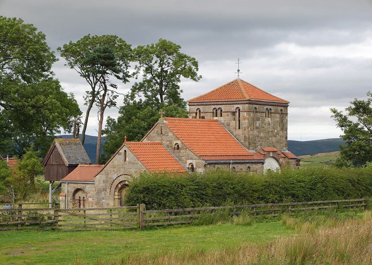 The chapel nestles into the slope in a one-time farmyard.