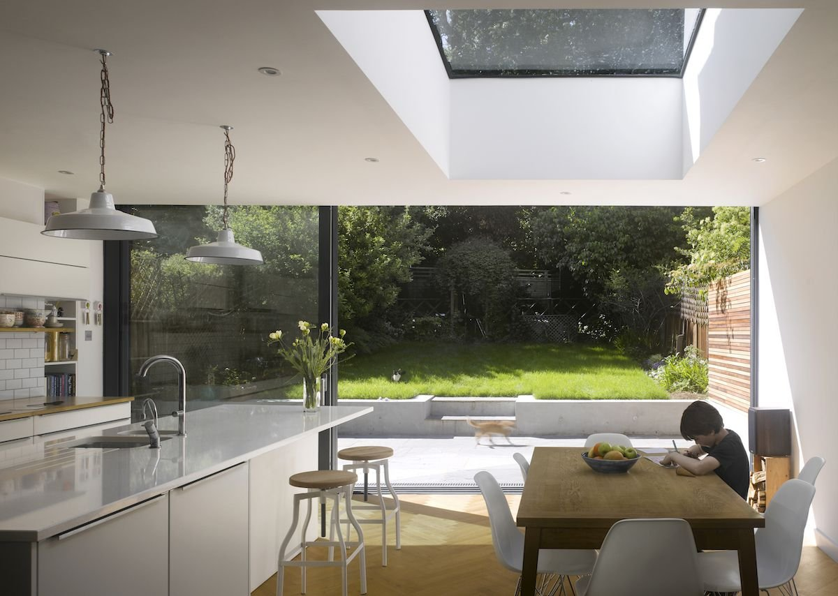 Flushglaze rooflight helps merge garden and sky in this Edwardian terraced house.