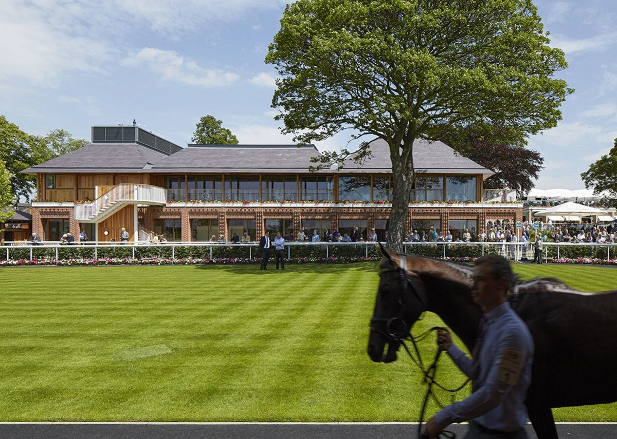 View of the weigh-in building with pre-parade ring in the foreground.