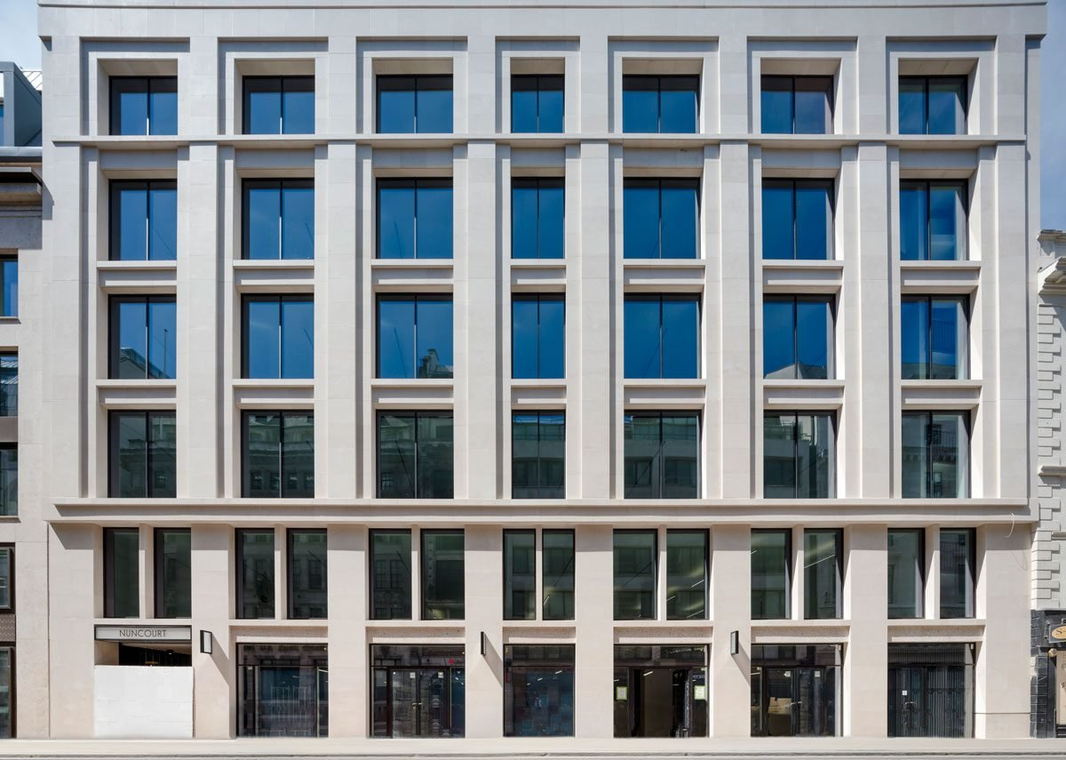 On Moorgate the facade is in fine-grained Portuguese limestone.  New Nun Court alley emerges on the left.