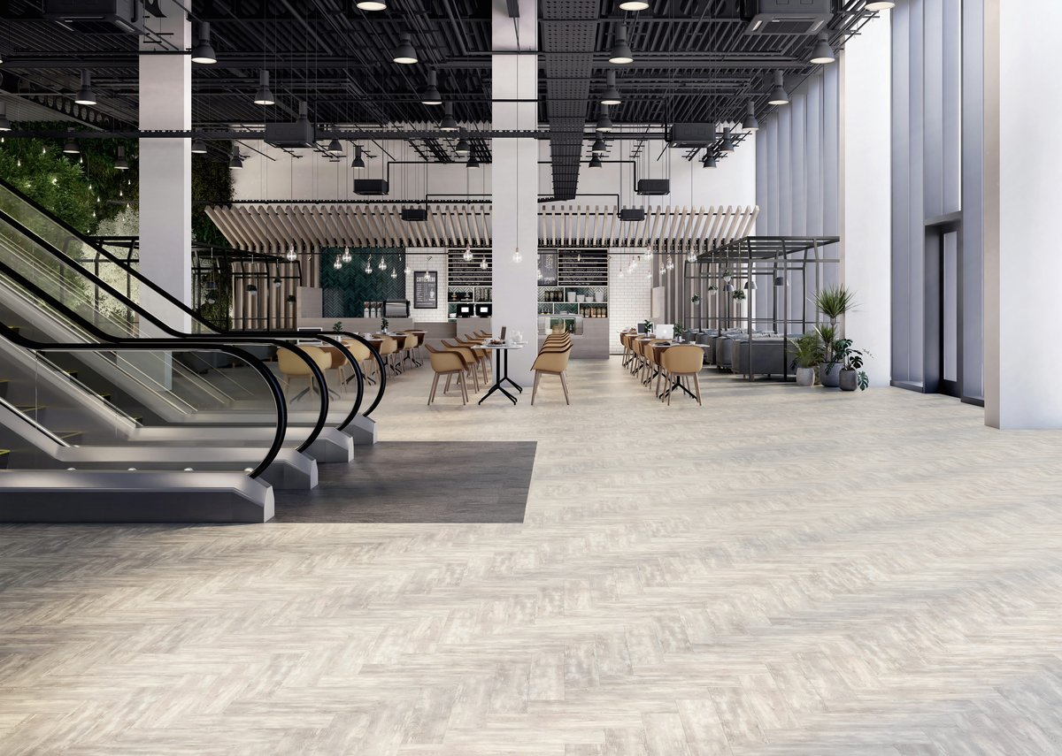 Herringbone wood-effect Halo Pine and stone-effect Stria Volcanic Signature 36+ luxury vinyl tiles.