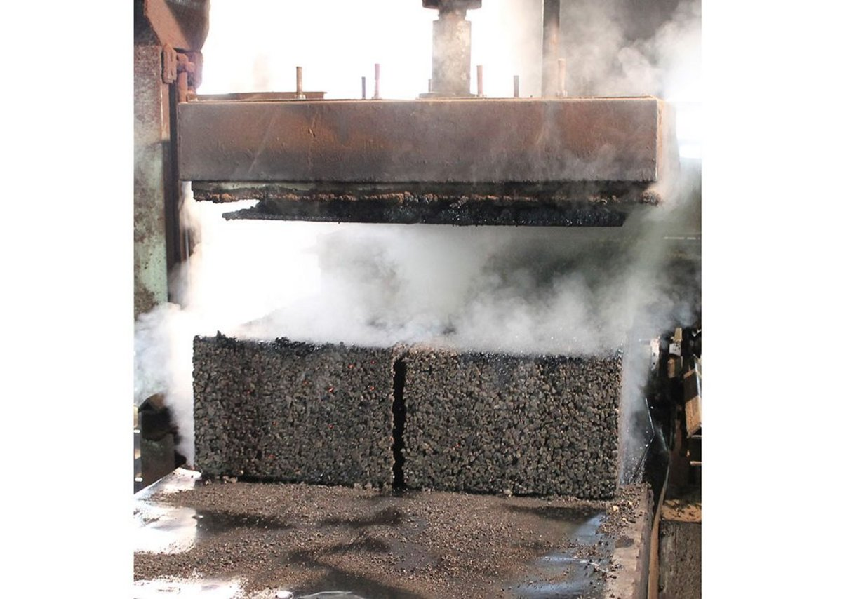 A freshly cooked expanded cork block emerging from the autoclave at Amorim Islamentos, Vendas Novas, Portugal.