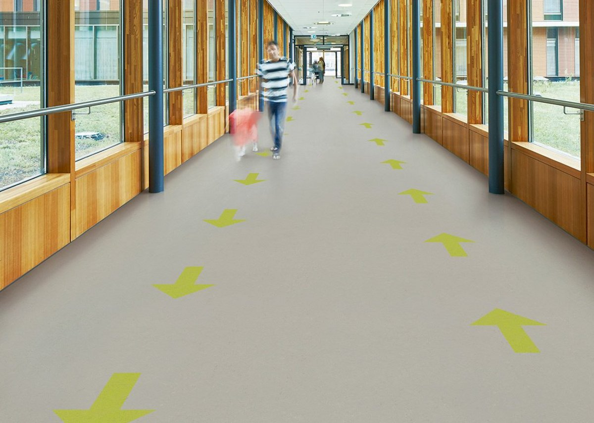 Marmoleum sheet flooring with solid arrows: Forbo can also supply loose arrows to be cut into existing resilient installations.