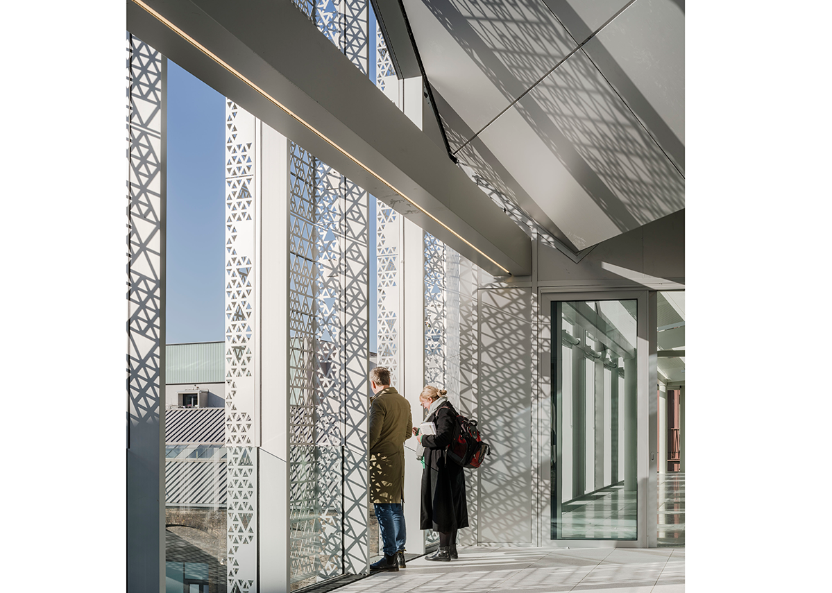 Handyside Street by Coffey Architects. The use of perforated aluminium screens create ever- changing lighting effects within the workspace. Photo © Tim Soar.