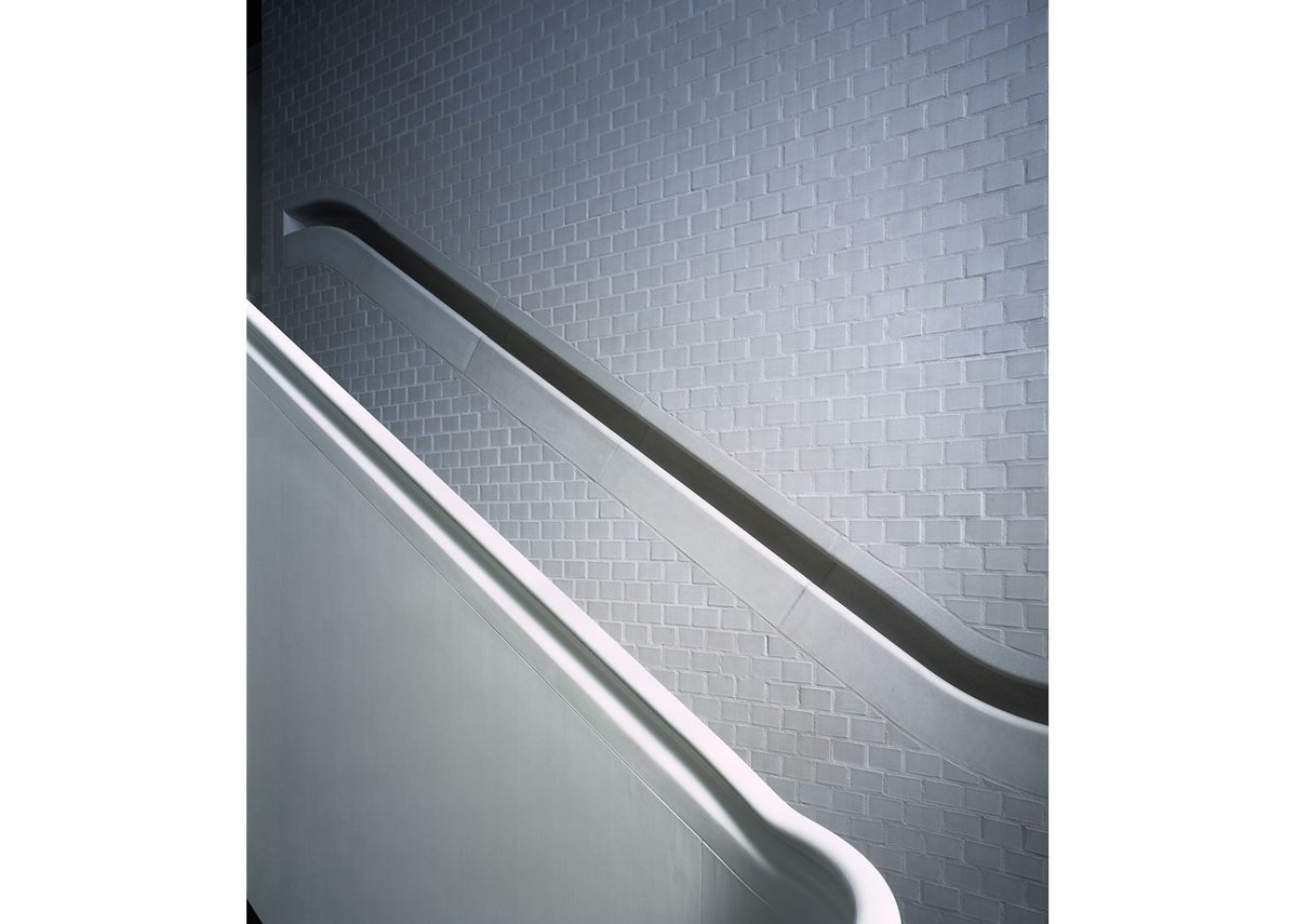 The recessed smooth concrete handrail is exquisite but tests the brick walls and its builders to the extreme.