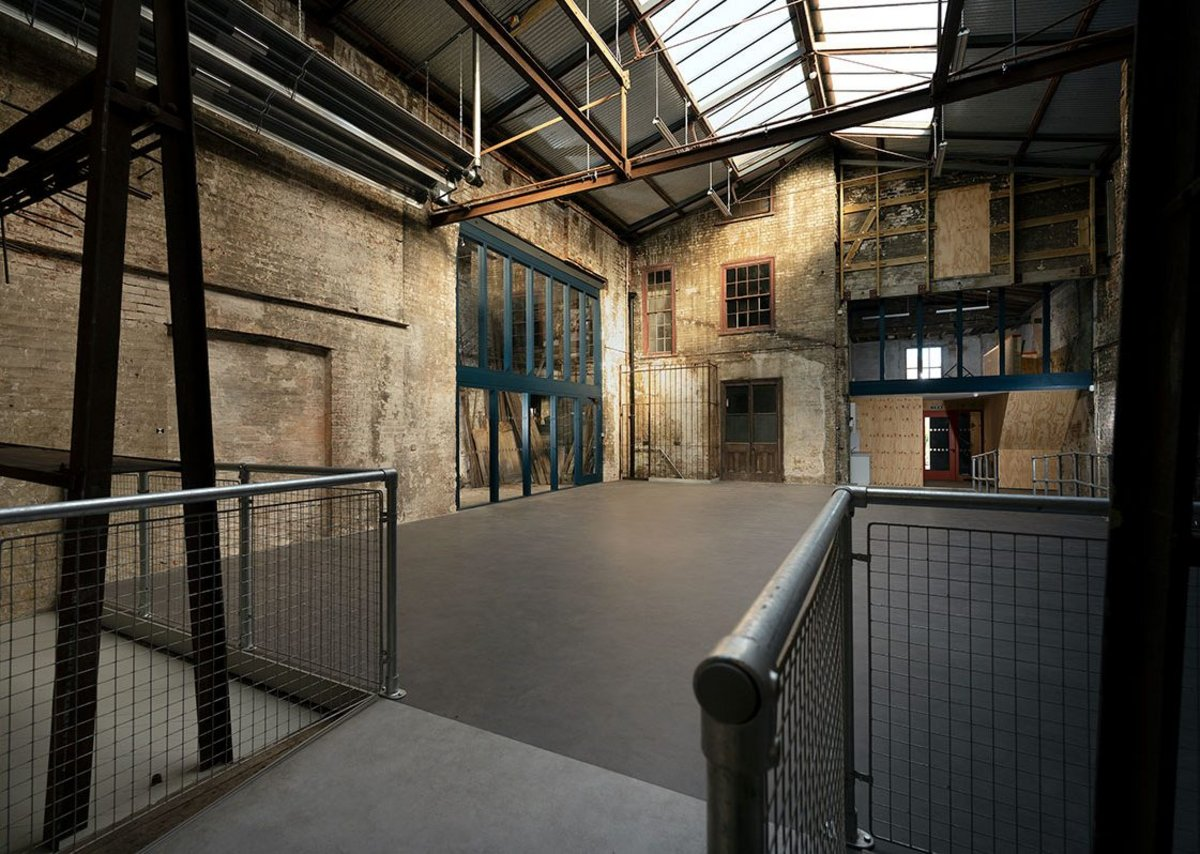 Pritchard Architecture inserted a new floor into the warehouse space to enable new community uses at Treadgold.