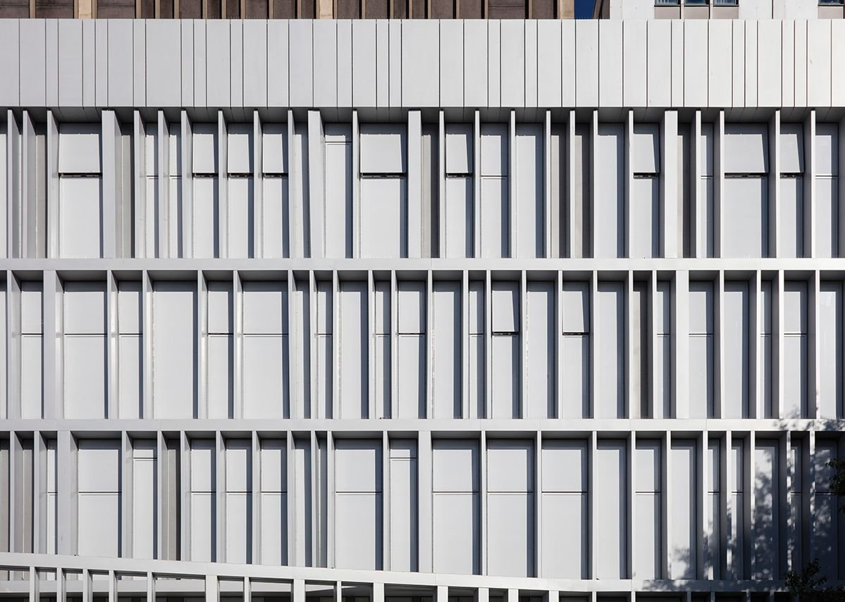 Panels and windows are covered with a micro-perforated film to merge them into one.