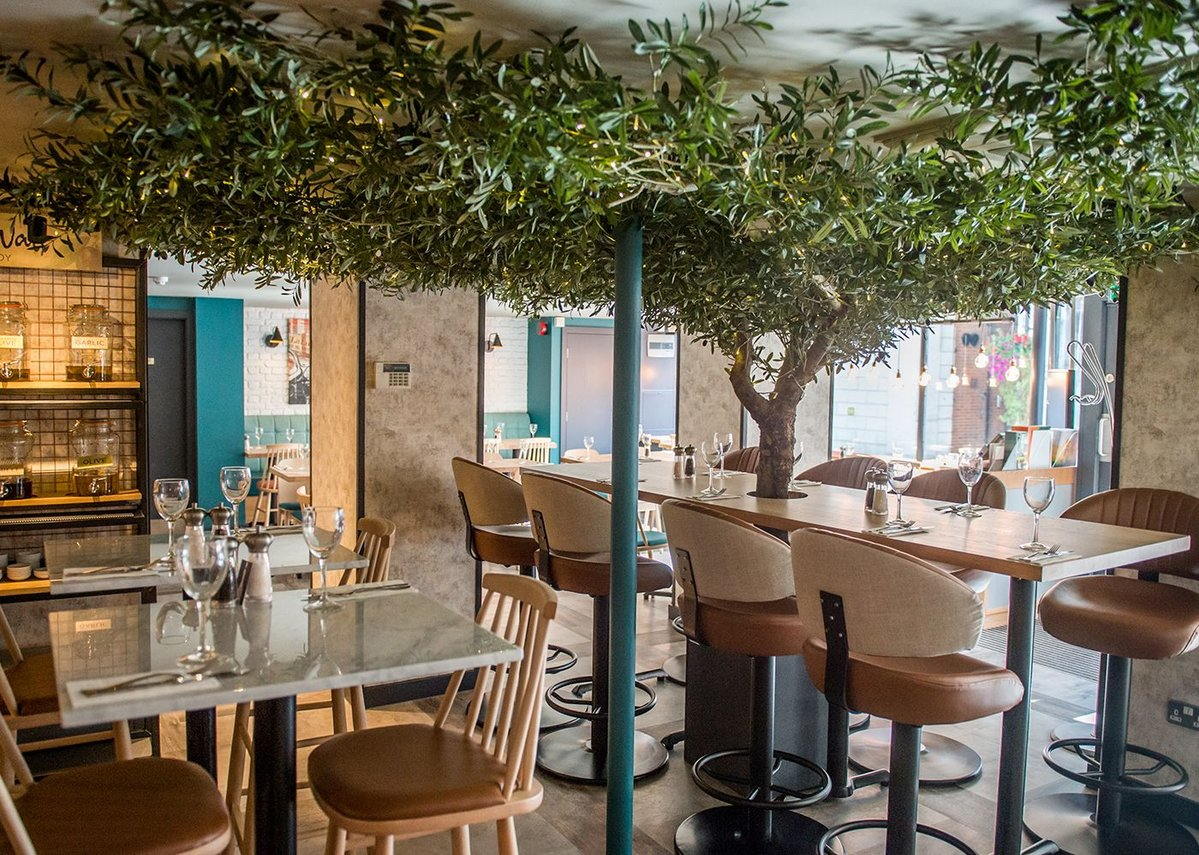 Level Set wood and stone-look tiles complement the olive tree feature in Prezzo's Bracknell branch.