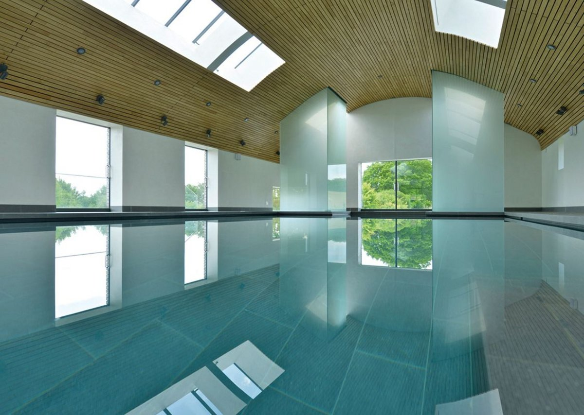 The pool house might look understated but with a sauna and steam room, it uses 80% of the site's energy demand.