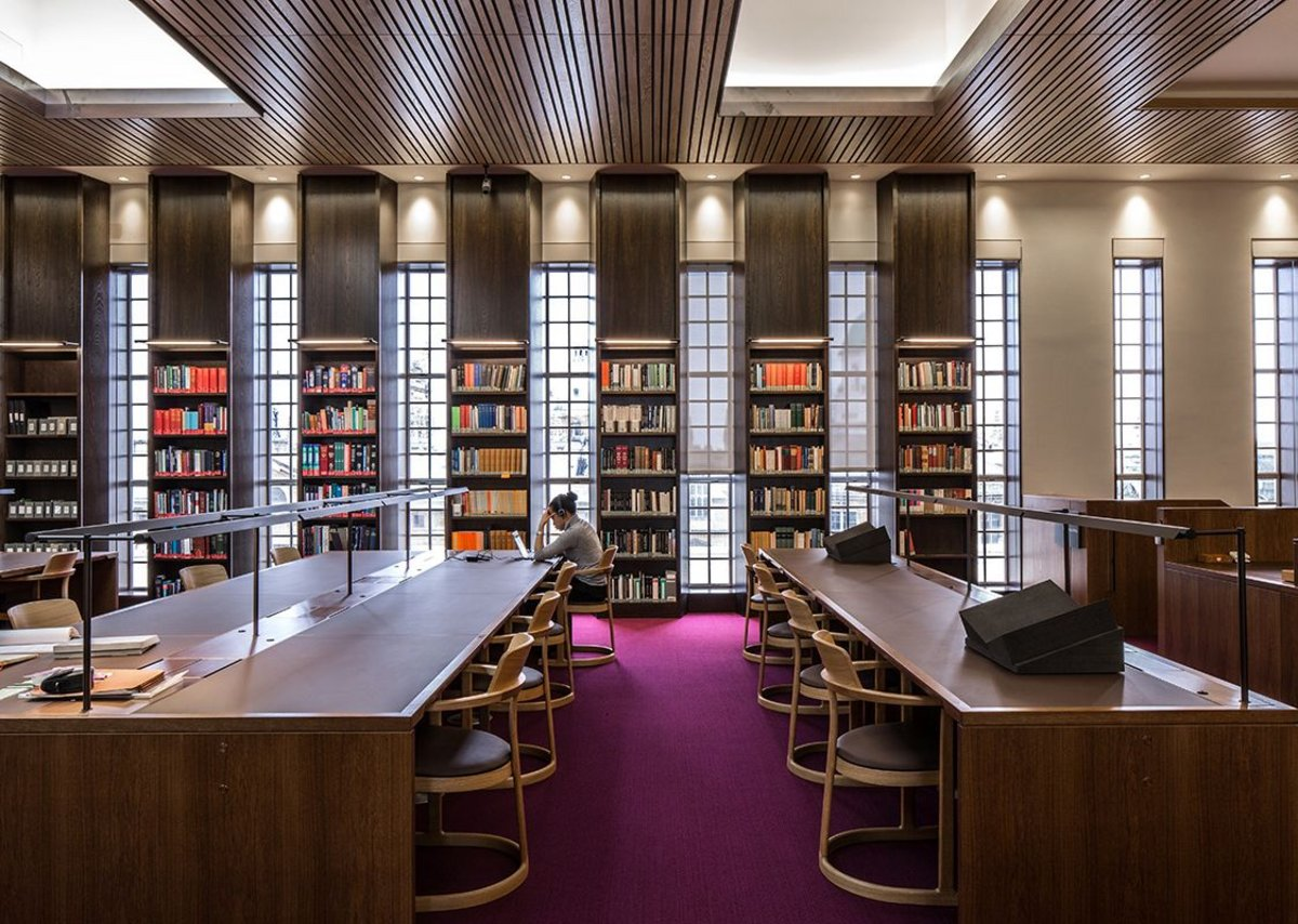 The David reading room, kitted out in stained European oak, picks up on Scott's original fenestration lines.