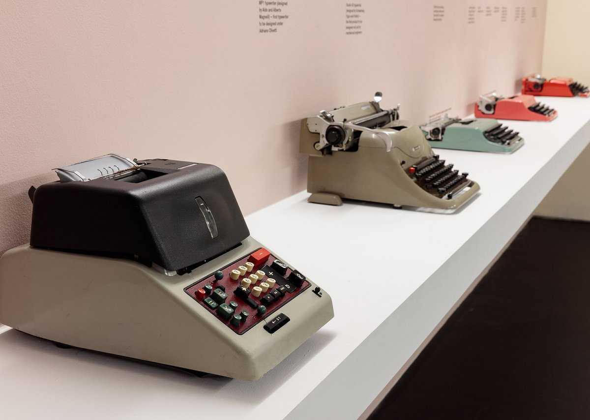 Olivetti products line up in the exhibition Olivetti Beyond Form and Function.