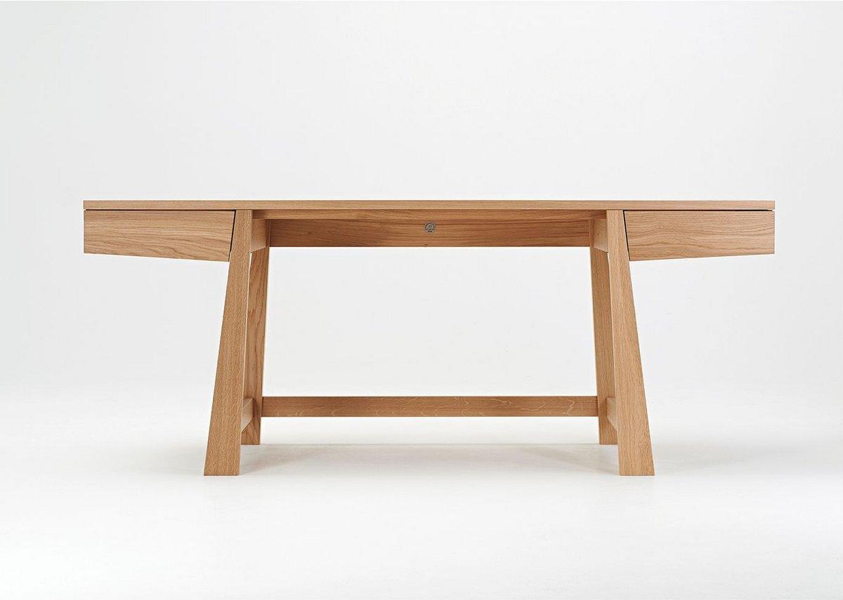 The desk shows a subtle oriental influence.