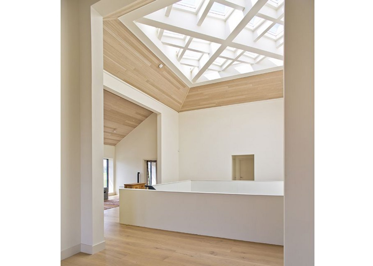 The bespoke rooflight in the atrium features concealed motors that are linked to the building management system and heat and rain sensors.