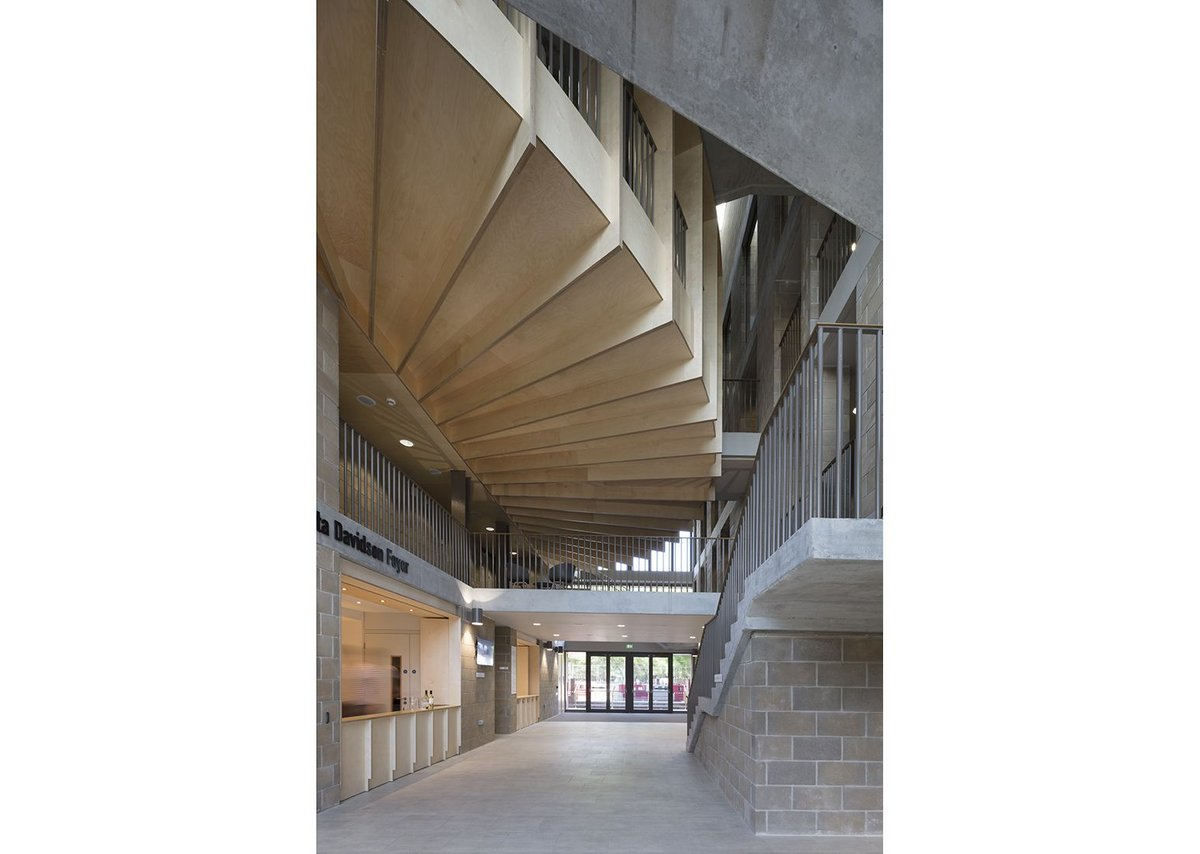Timber first-floor gallery fans round the curved rear of the main practice theatre.