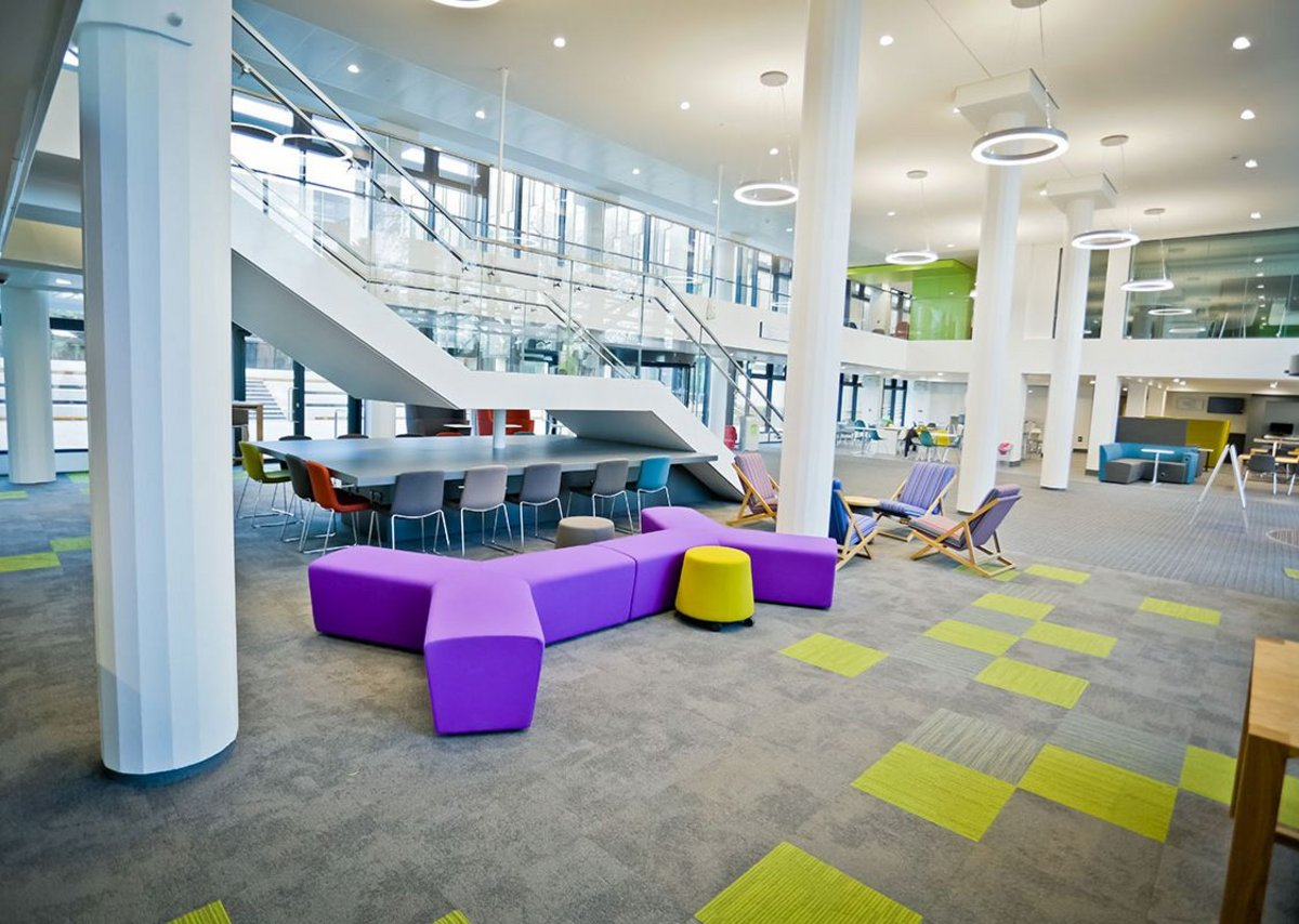 Interface multi-tonal modular flooring in the open space of the Gateway at Oxford Brookes University.