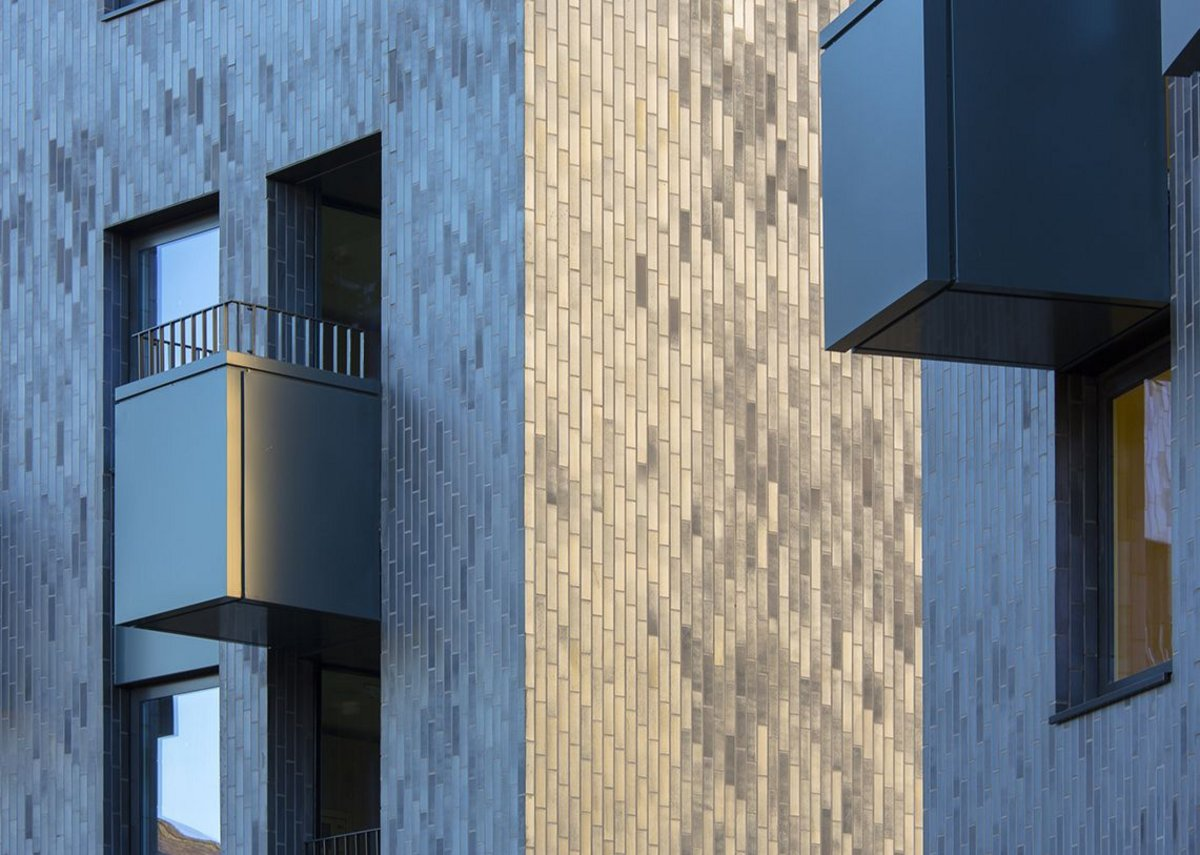 Closer-up of brick brick-dimension tiled facade