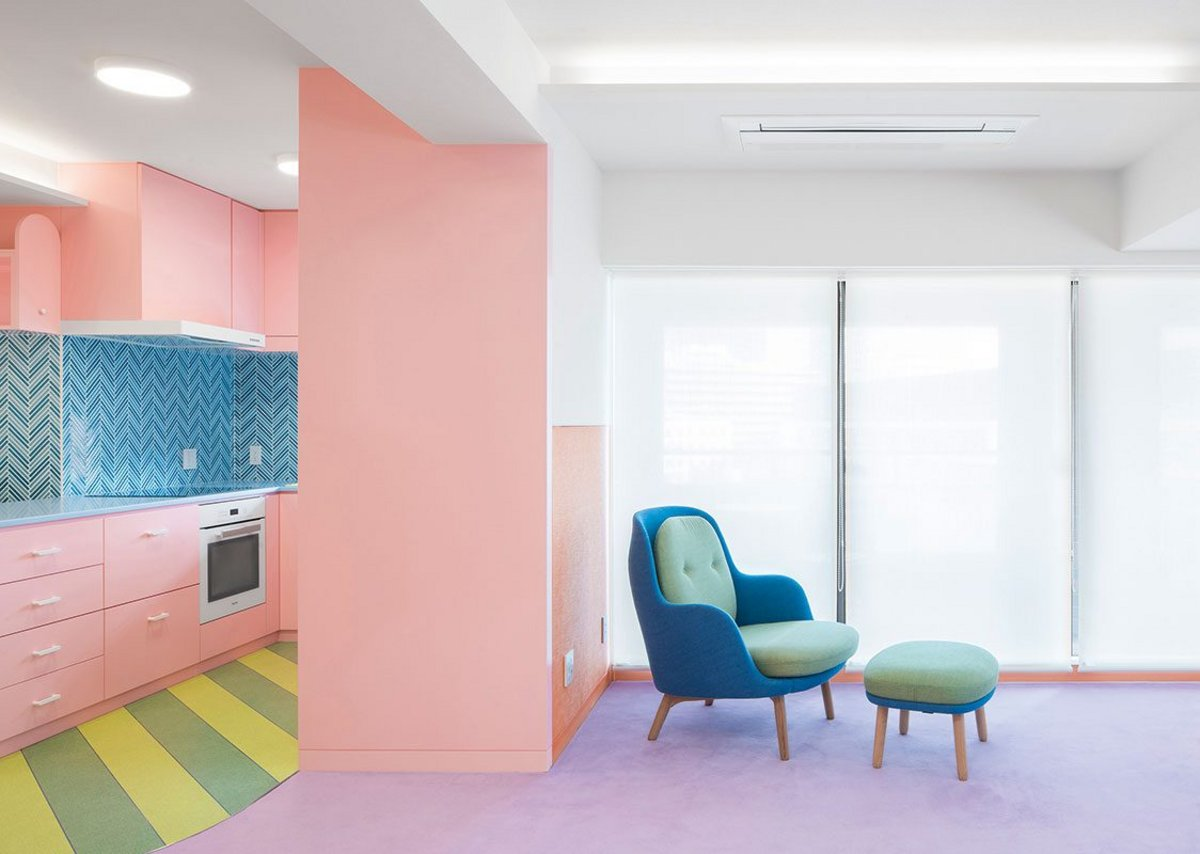Baby pink pastel seems almost sedate juxtaposed against other colours in the space.