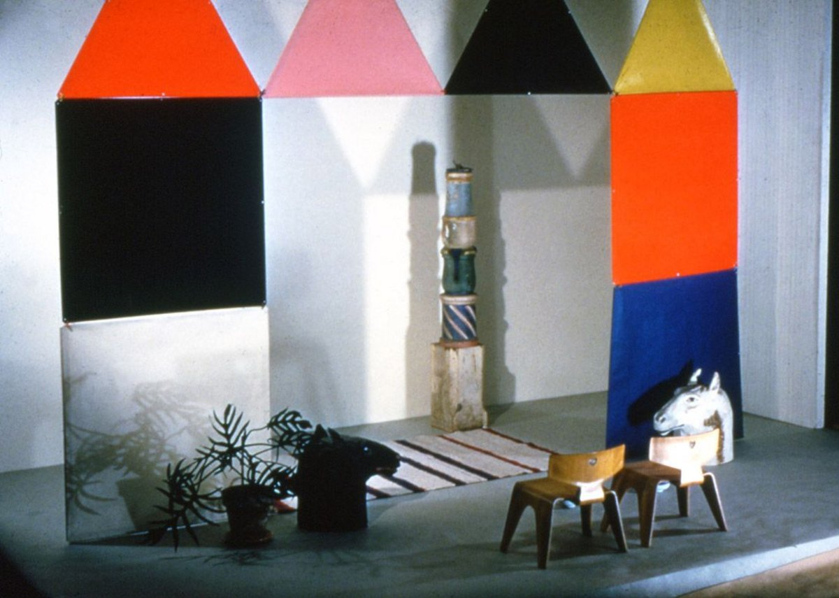 Tableau of The Toy and plywood children's furniture set up in the