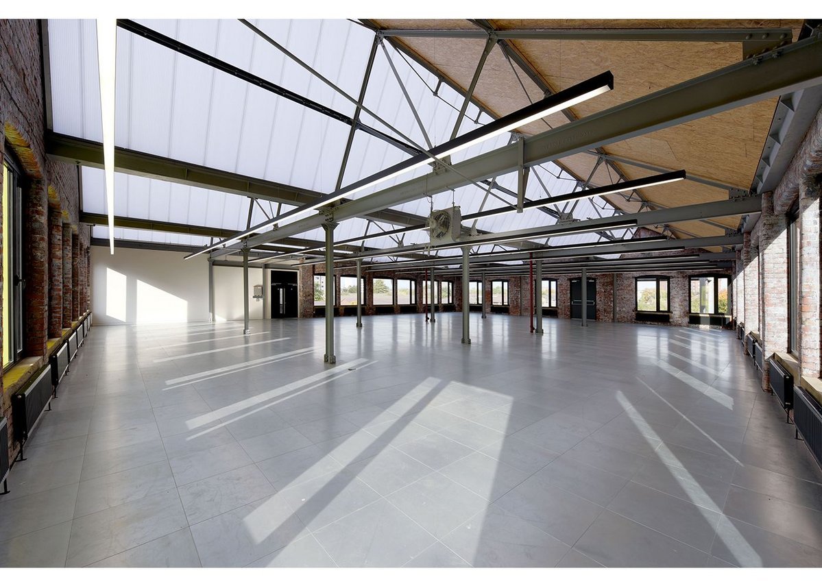 Inside Stubbs Mills Sixtwo has substituted glazing for polycarbonate roofing and left SIPPS panels exposed.