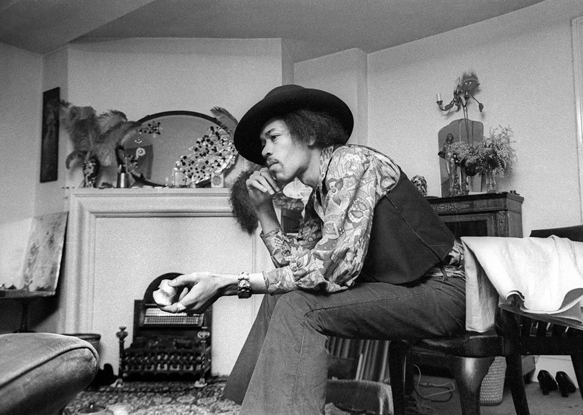 Jimi Hendrix at 23 Brook Street, 1969. The original oval mirror is part of the recreated bedroom.