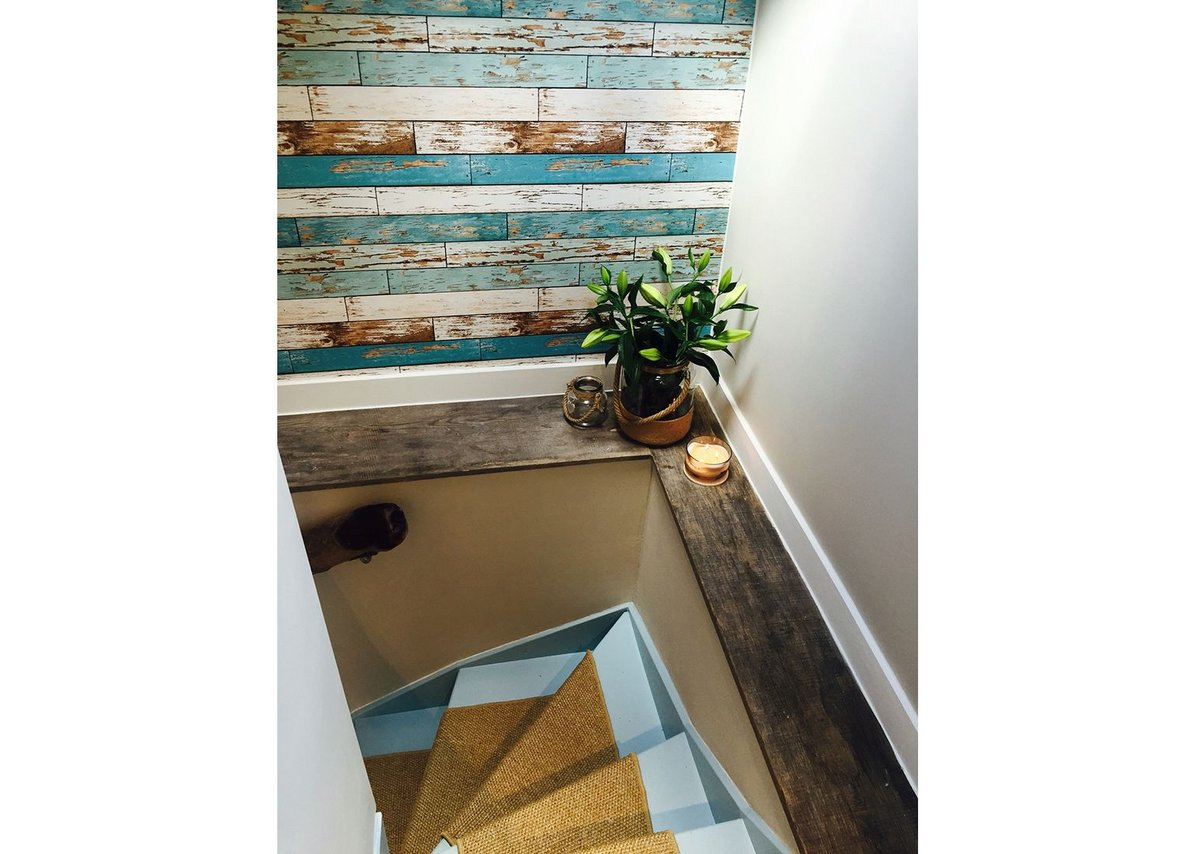 Walls in the snug stairwell featuring reclaimed wood and insulated with Celotex GA4000