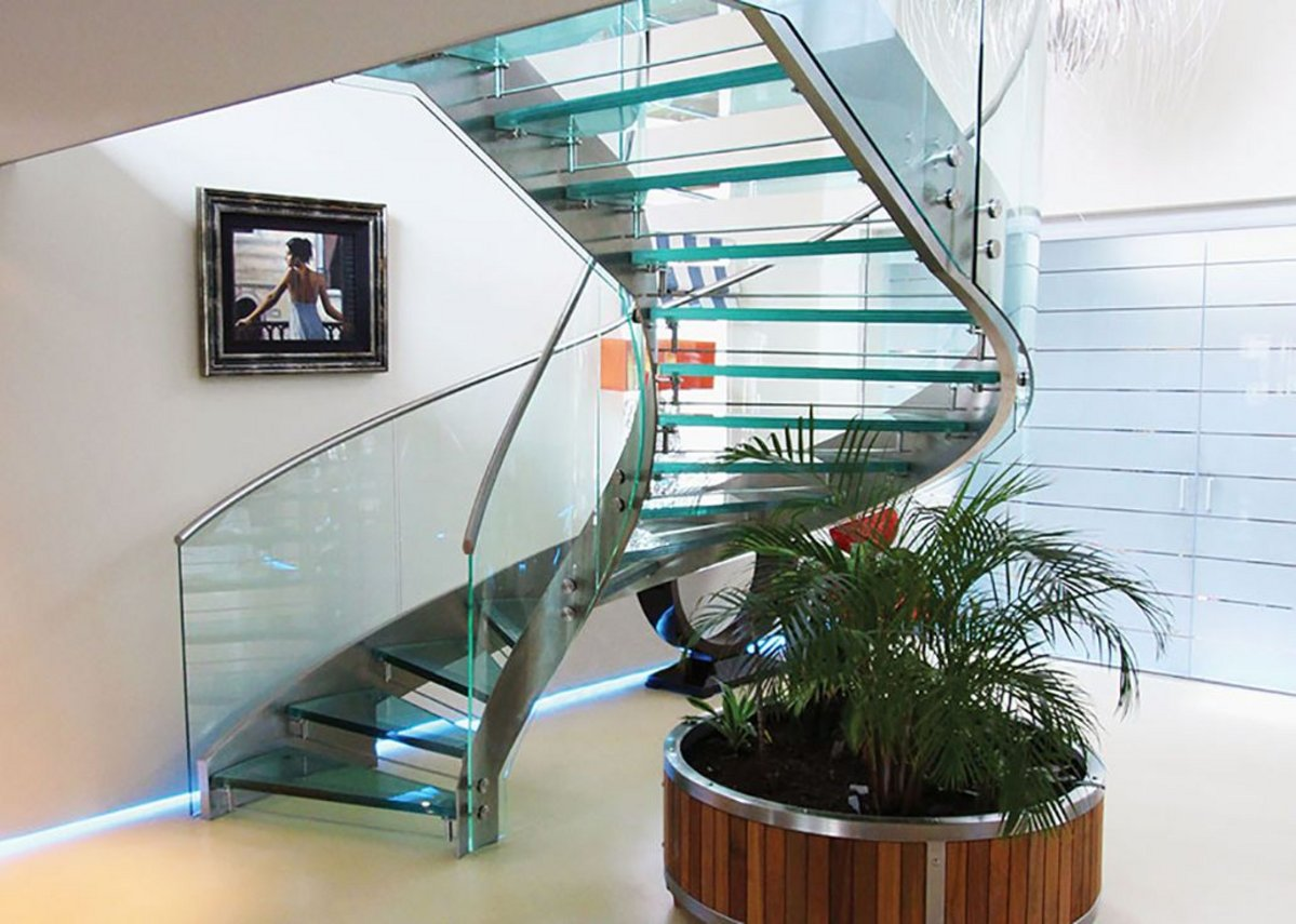 Glass and satin polished stainless steel helical staircase.