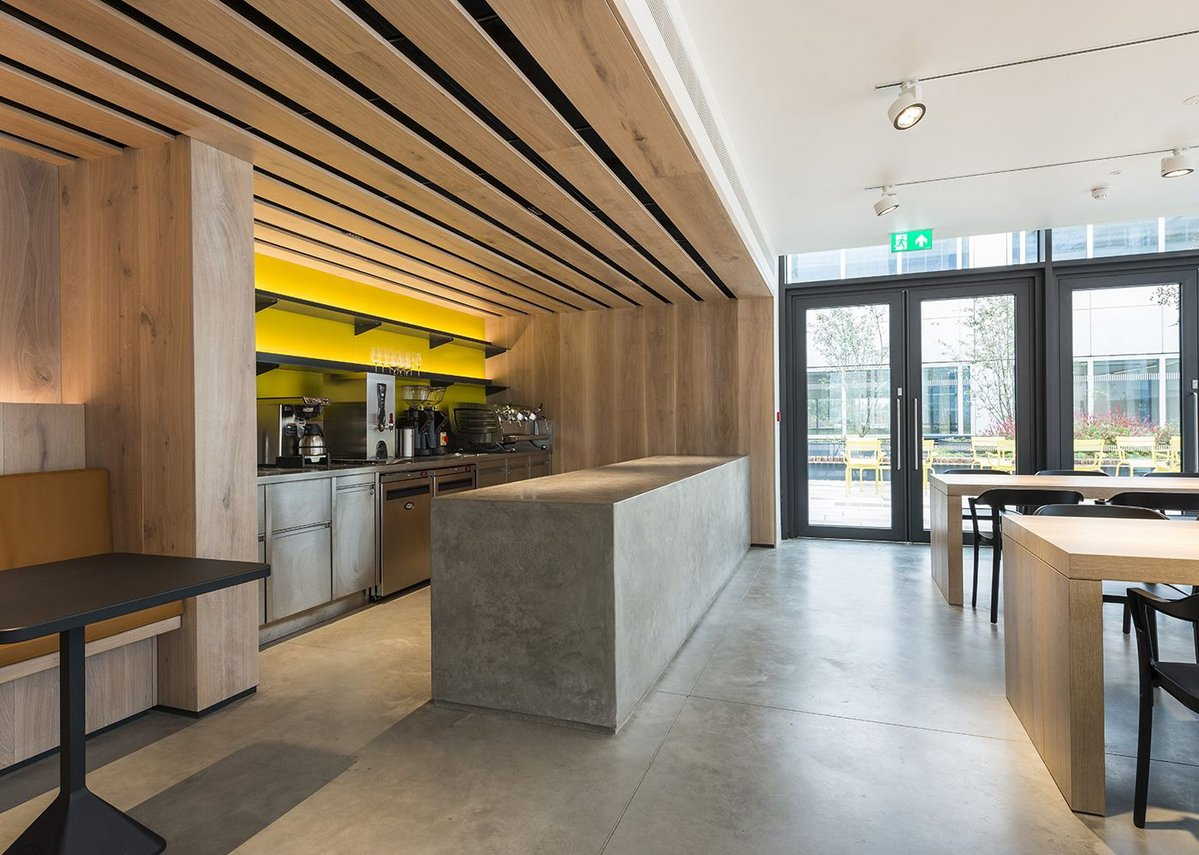 Lazenby's Cool Grey polished concrete and cast insitu restaurant counter.