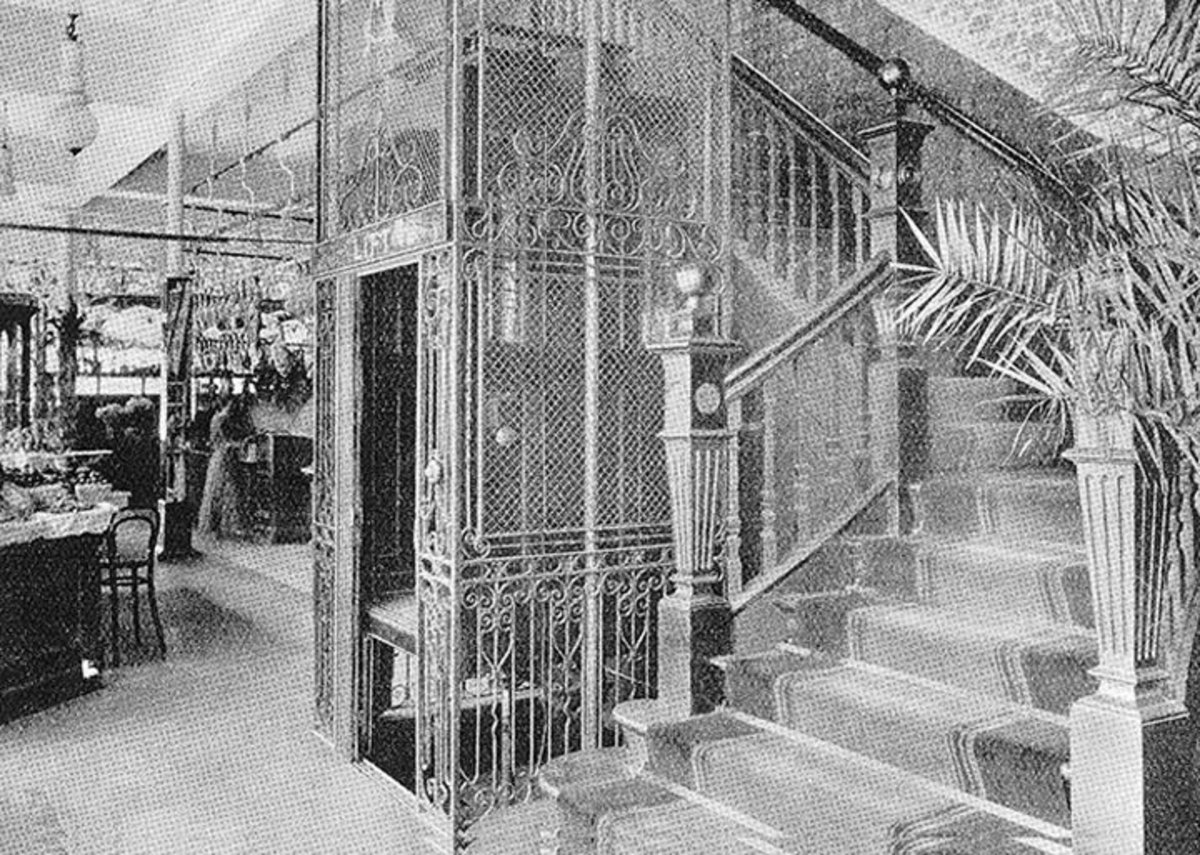 An early highly ornamented Stannah lift shown in black and white.