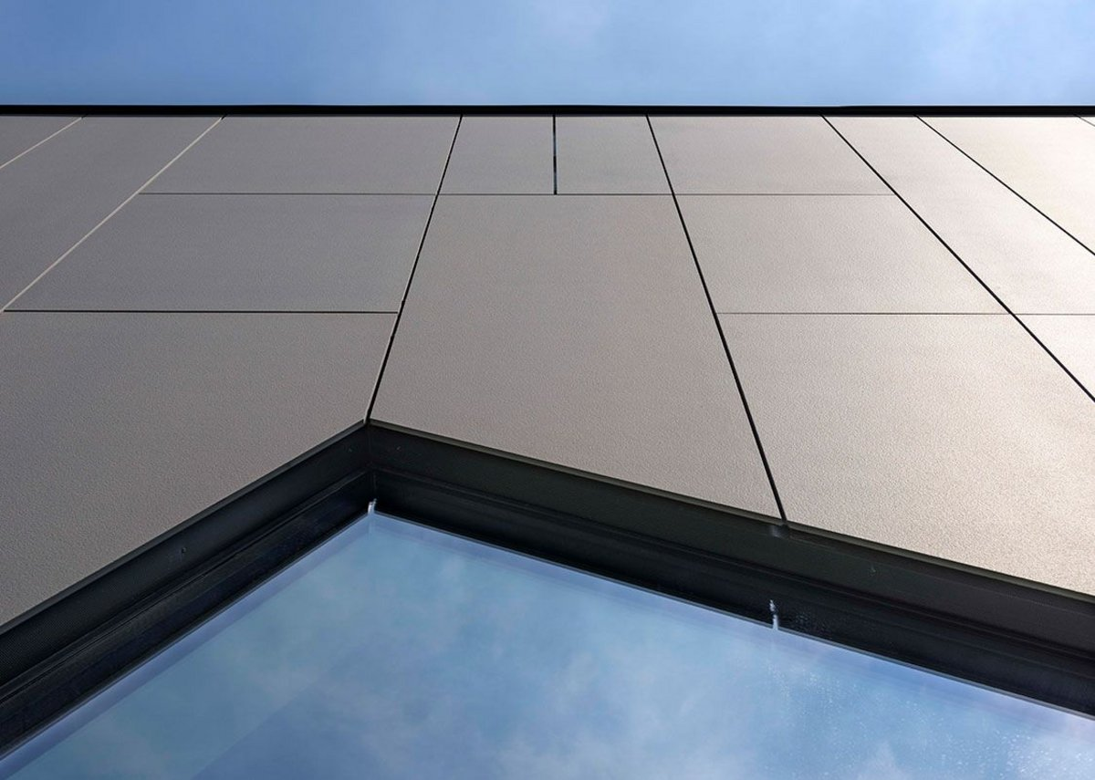 Lapitec ventilated facade using large format, 12mm panels in Grigio Piombo Vesuvio (textured finish). Every slab is resistant to acids, alkalis, deep abrasion, fire and frost and is unaffected by UV rays.