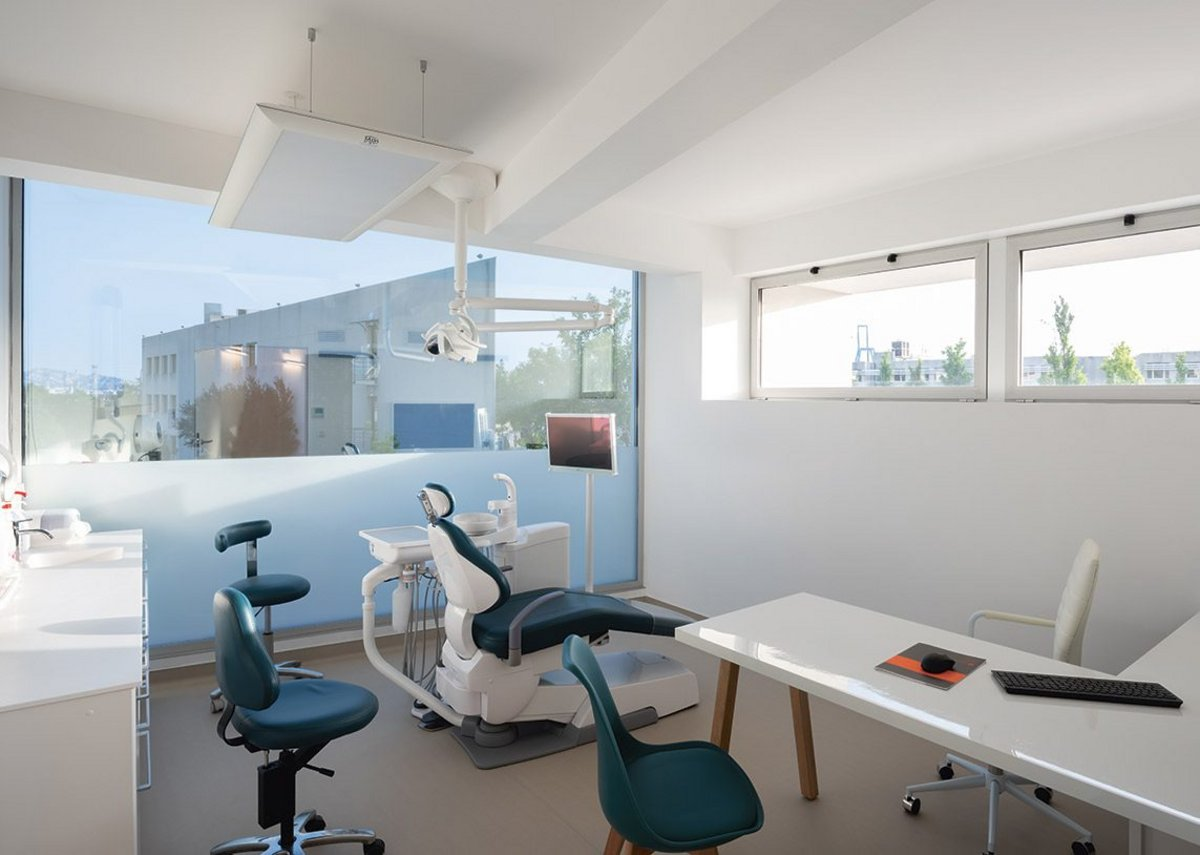 The first floor treatment room with its huge picture window. Here walls are white and more stereotypically dental studio.