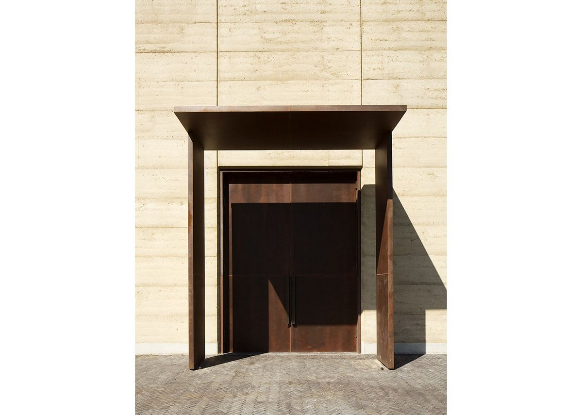 Oversized CorTen doors mark the points of entry and exit.