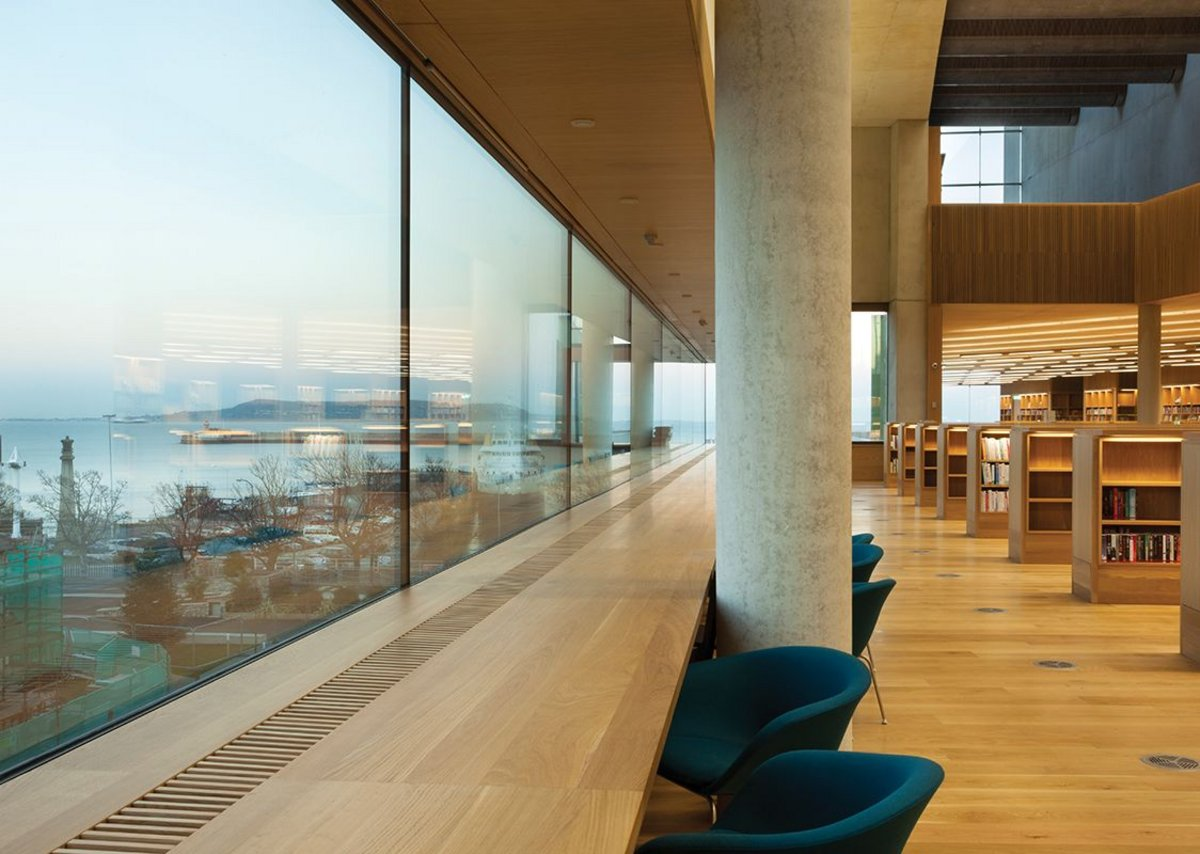 Unobtrusive framing maximises sea views from the library.