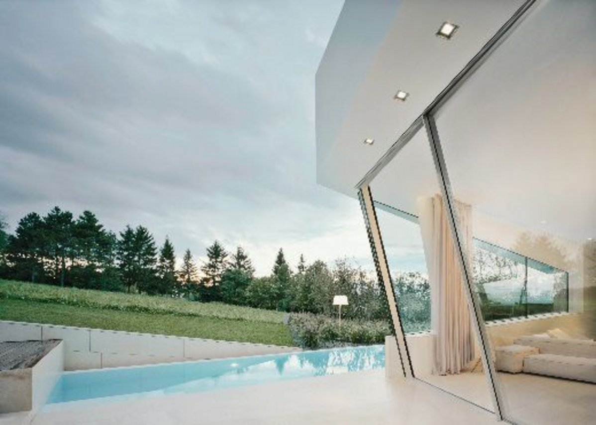 Sky Frame Slope by Sky Frame; the first ever frameless inclined sliding door.