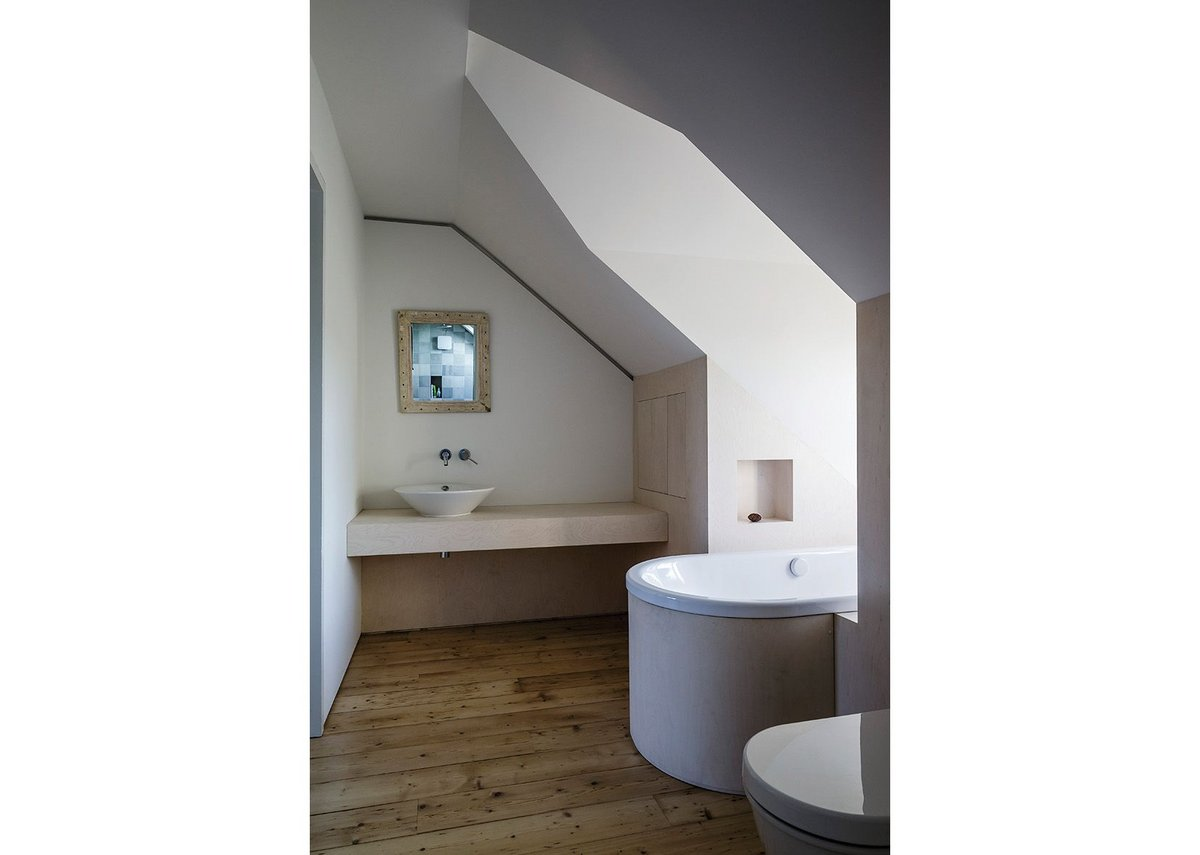 En suite bathroom with bath lengthways into the dormer.