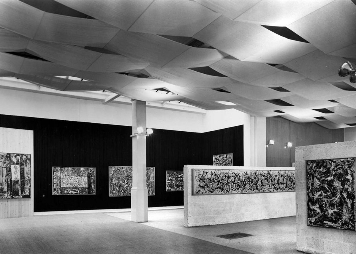 Installation view of Jackson Pollock exhibition 1958, designed by Trevor Dannatt at the Whitechapel Gallery. © Whitechapel Gallery. Paintings were hung on a variety of fabric, wood and breezeblock backgrounds.