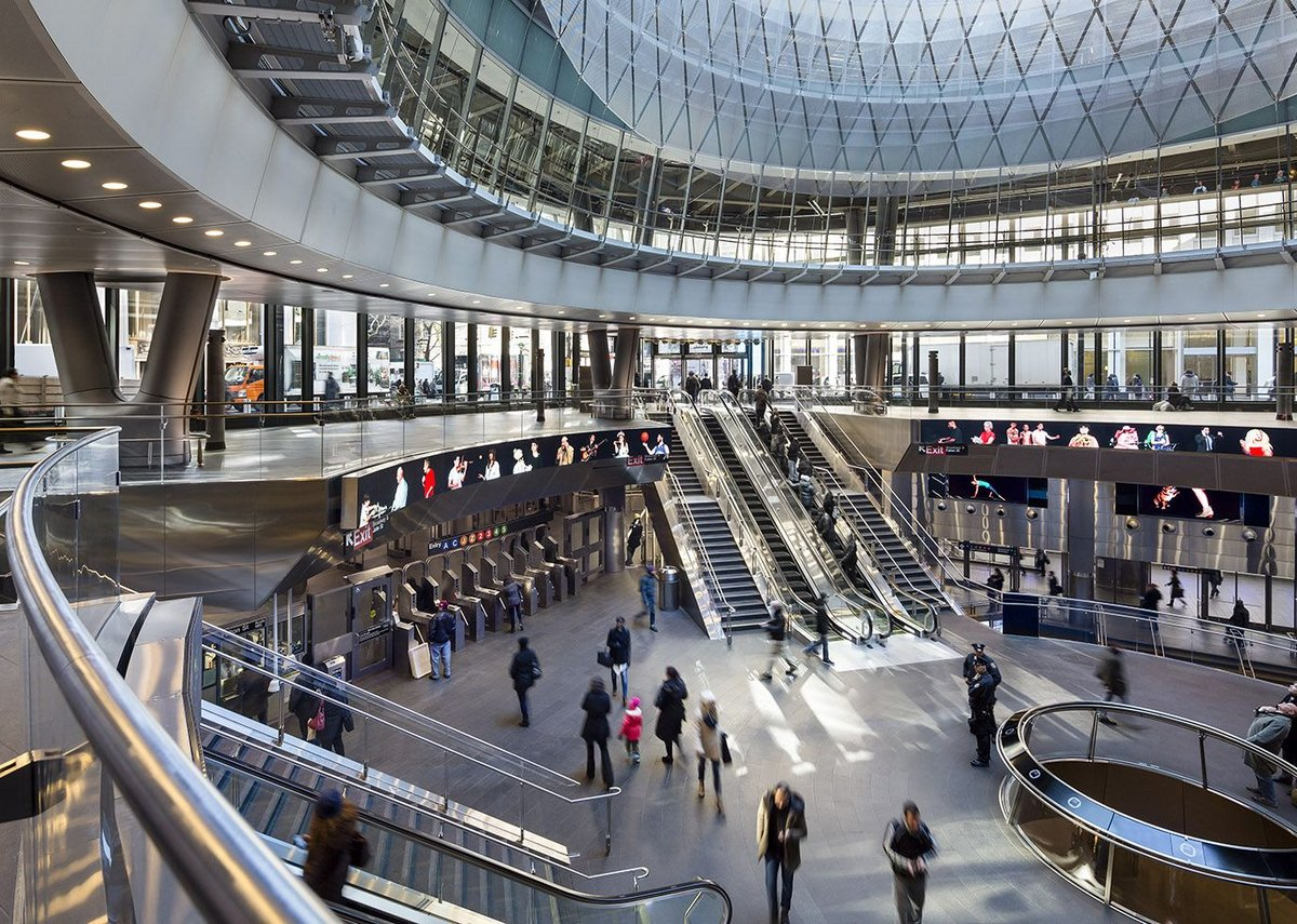 The Fulton Center descends two levels below the street: a mini-oculus brings daylight to the platforms below.