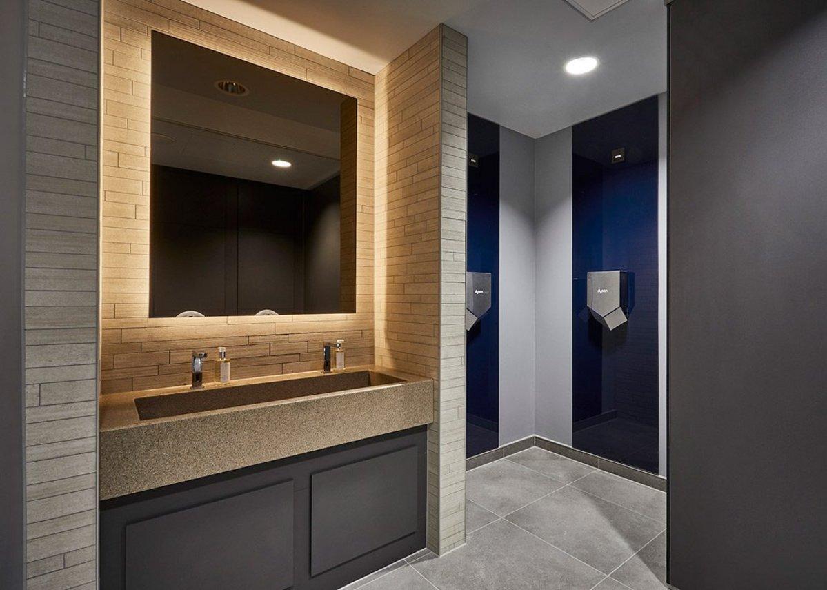 Interlocking concrete-effect Cemento tiles on the walls of the stadium washrooms.