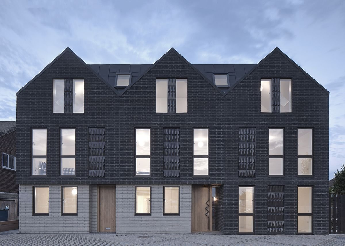 Denizen Works' Haddo Yard housing in Whitstable features bespoke ceramic tiles by Darwen Terracotta. These are faceted in reference to the gabled form of the building.