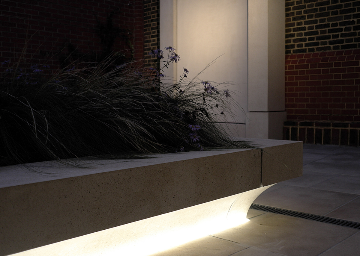 Underlit precast planters double as benches.