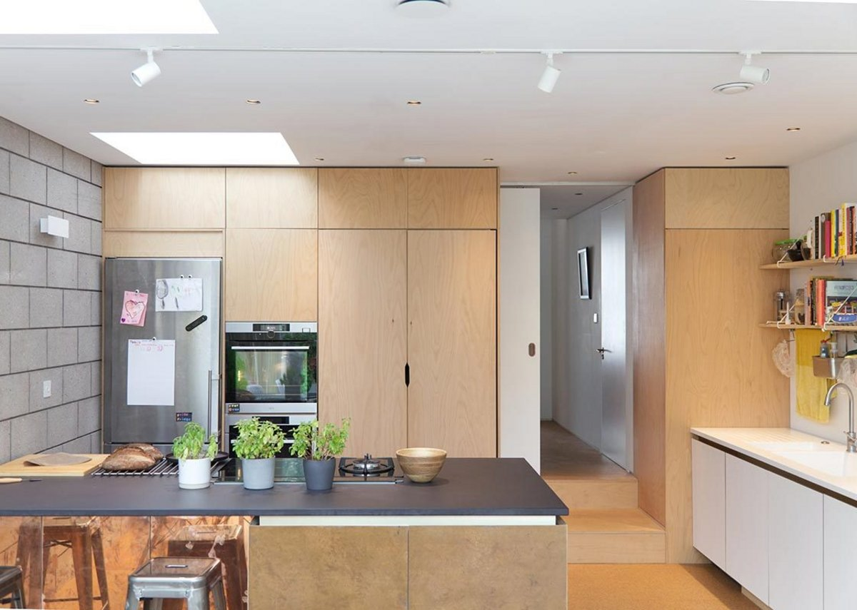 The kitchen is positioned, as in many Victorian refurbishment projects, across the back overlooking the garden.