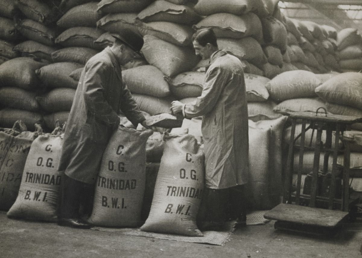 Retying sugar sacks after sampling, West India Docks.