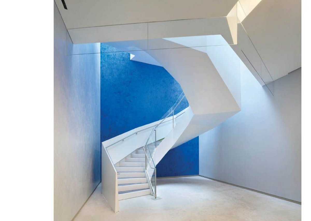 A splash of  richly coloured plaster marks Maki's staircase linking the auditorium foyer levels.